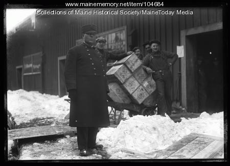 Men unloading contraband liquor, ca. 1920