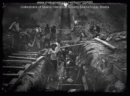 Men working in sewer trench, ca. 1920
