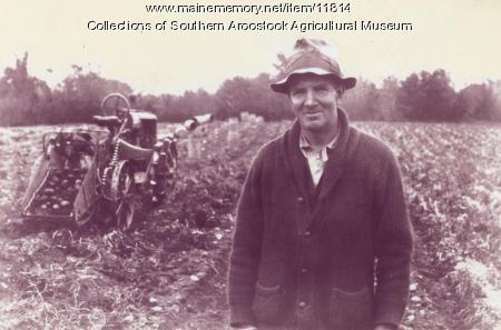 Willis Longstaff with tractor, Houlton, 1936