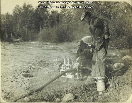 Setting up fire pump, ca. 1930
