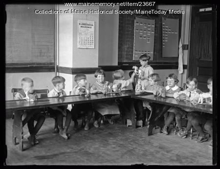 Children showing toys, Maine School of the Deaf, 1925
