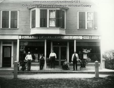 F. H. Townsend posing in front of his store, Limerick, ca. 1905
