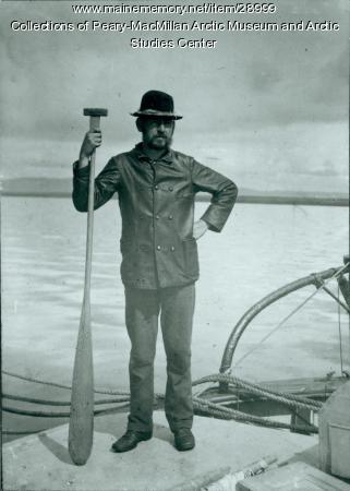 Austin Cary posing with equipment, Labrador, 1891