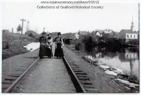 Ladies on the railroad tracks in Guilford, ca. 1880
