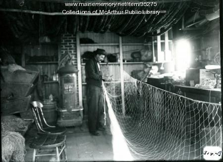 Fisherman repairing nets at Biddeford Pool, 1917