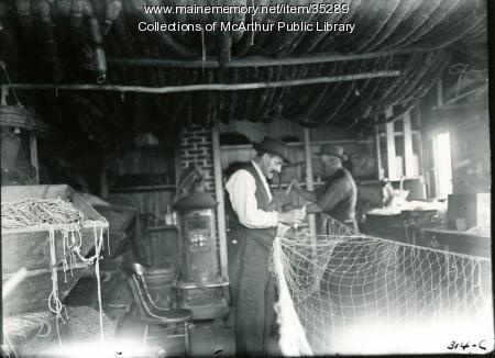 Fishermen repairing their nets, Biddeford Pool, 1917
