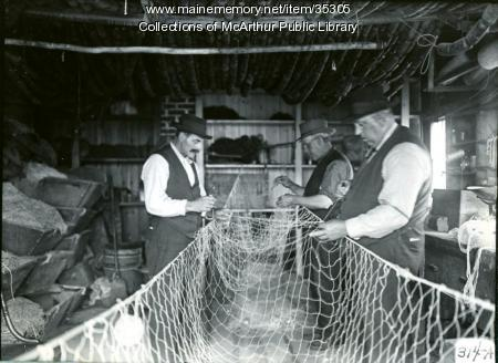 Repairing fishing nets at Biddeford Pool, 1917