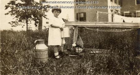 Ellie Macomber feeding chickens, Fairfield, ca. 1925