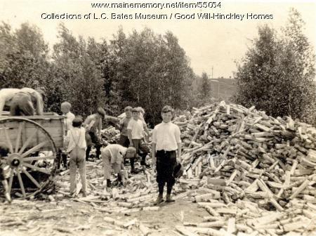 Good Will boys loading wood, Fairfield, ca. 1930