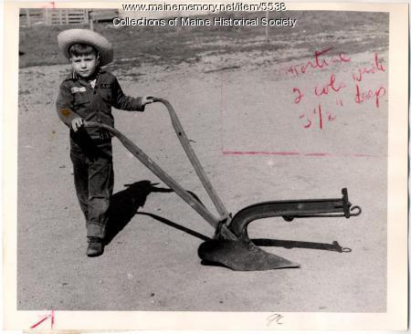 Robert McKeen with plow, Norway, 1958