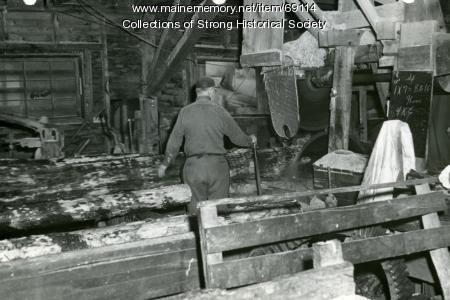 A large log runs through the saw, Starbird Lumber Co., Strong, ca. 1955
