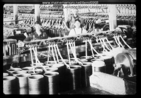 Workers inside a  textile mill circa 1900
