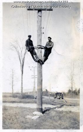 Electric linemen on pole, 1930