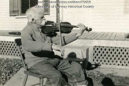Mellie Dunham playing his fiddle, Norway, ca. 1927
