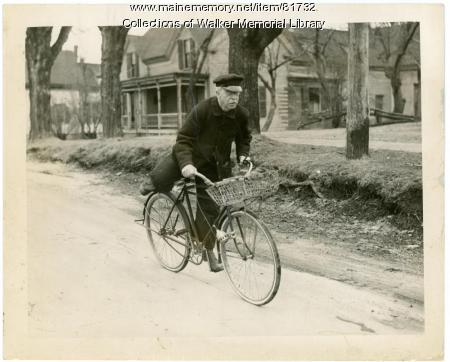 Henry F. Smith 72, on bicycle, Westbrook, 1940