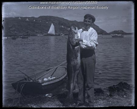 Fisherman Ernest L. Smith with codfish, Monhegan, 1910