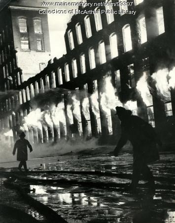 Flames rolling though the windows of Grafton Lumber, Biddeford, 1963