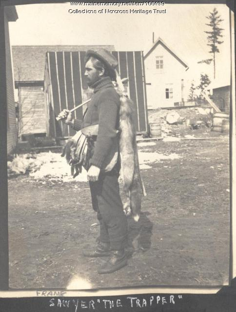 Bob Sawyer with pelts, Norcross, ca. 1910