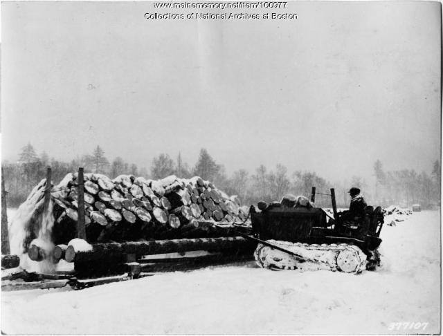 Tractor pushing pulp logs on ice, Magalloway Township, 1939