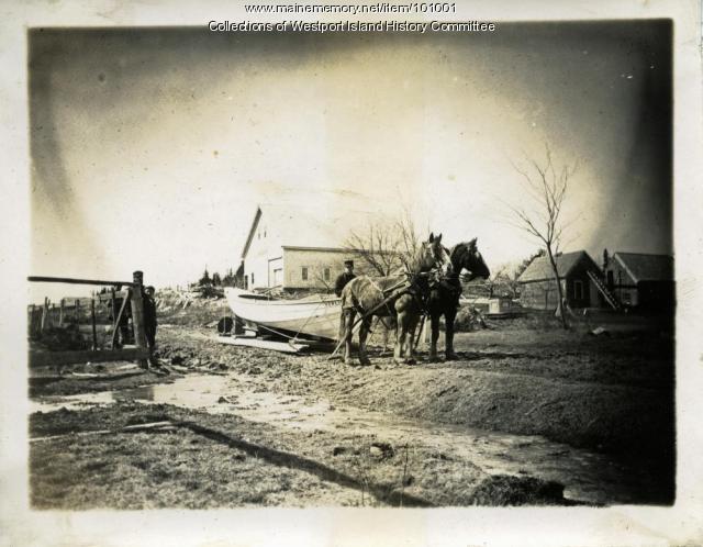 "Hauling the boat ""Verlie"" to shore, Westport Island, ca. 1900"