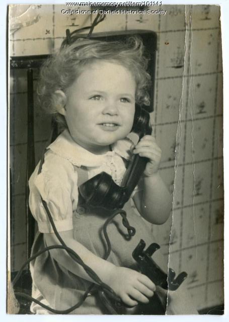 Donna Sue Collins with telephone, Dixfield, ca. 1948.