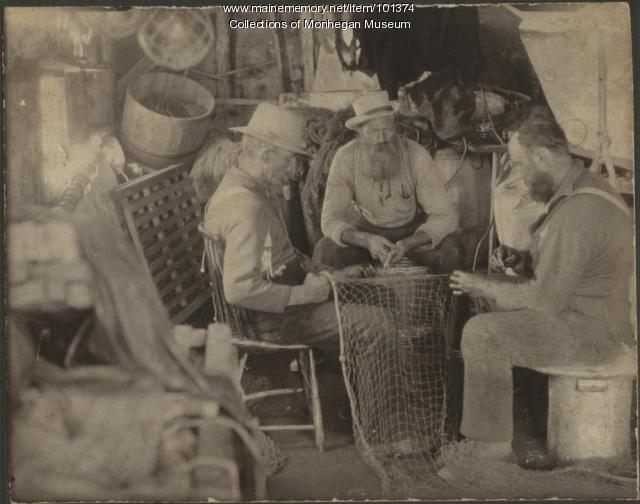 Mending nets at the Horn fish house, Monhegan, ca. 1880