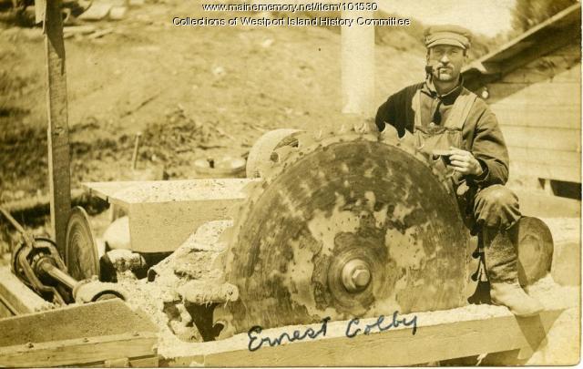 Ernest Colby sharpening saw blade, Westport Island, ca. 1918