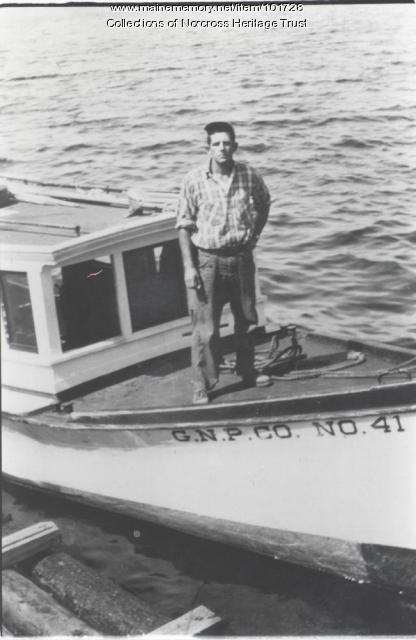 "Frederick Fowler on deck of ""GNP Co. No. 41"" boat, Lower Lakes West Branch, ca. 1947"
