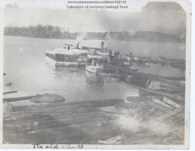 Loading at old wharf, Norcross, ca. 1900