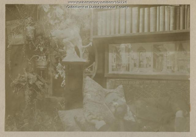 John Calvin Stevens asleep in his library, Portland, ca. 1900