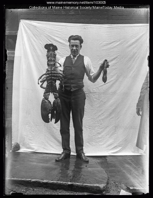 Carl A. Garris Jr. with lobsters, Portland, 1926