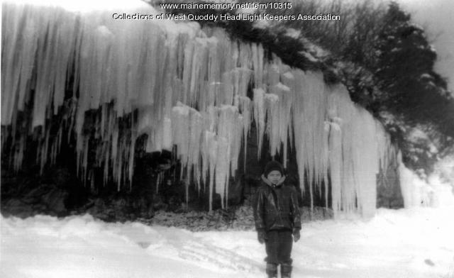 Bobby Gray at icicle-covered cliffs below lighthouse