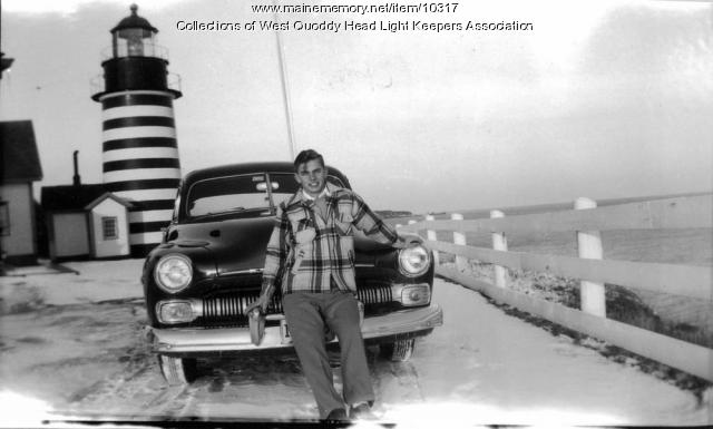 Bobby Gray and car, ca. early 1950s.