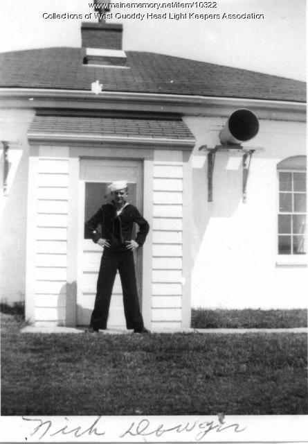 Coast Guardsman Nick Dowger at the West Quoddy Head Lighthouse, ca. 1940