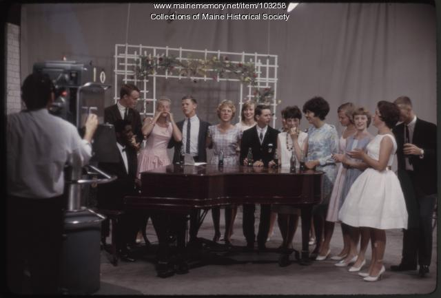 Students gather around a piano on The Dave Astor Show, Portland, 1962