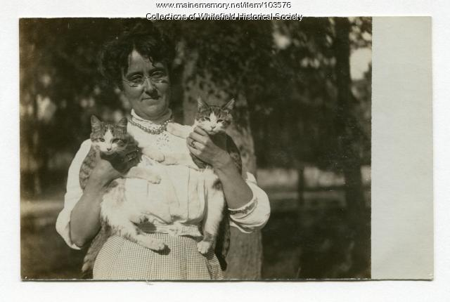 Sarah A. Weeks and kittens, Coopers Mills, Whitefield, ca. 1915