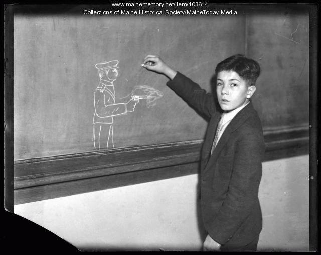 Boy with drawing of officer, ca. 1935