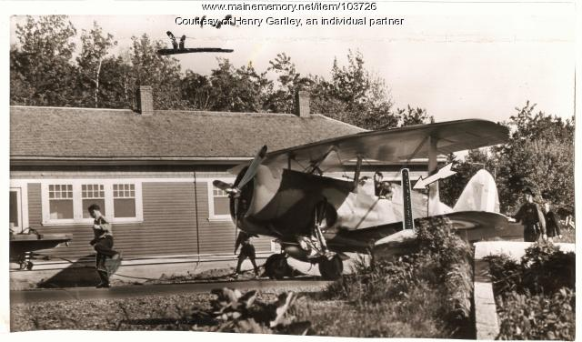 Plane pulled across Canadian border in Houlton, 1940