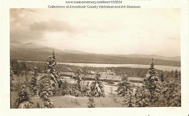 Civilian Conservation Corp camp overview with lake, ca. 1937