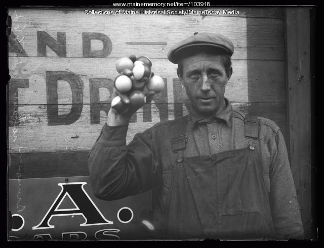 Percy Graffam holds pool balls in one hand, Portland, 1927