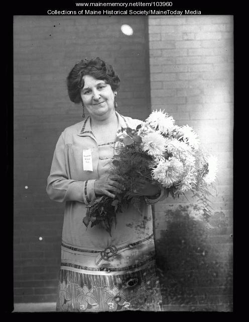 Myra Powers McLean holding a bouquet, 1926