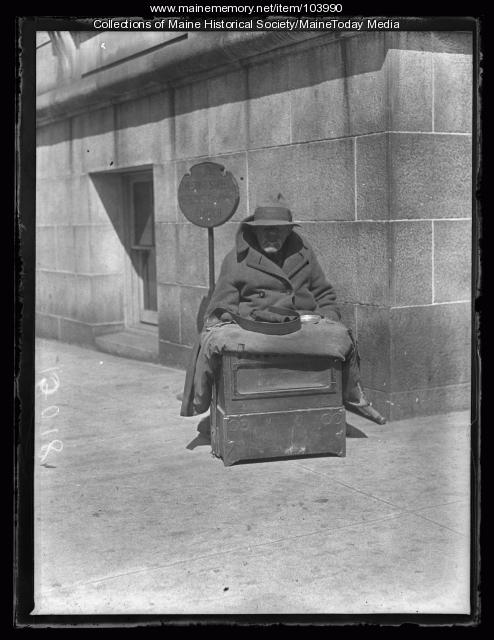 Beggar playing hand organ, Portland, 1927