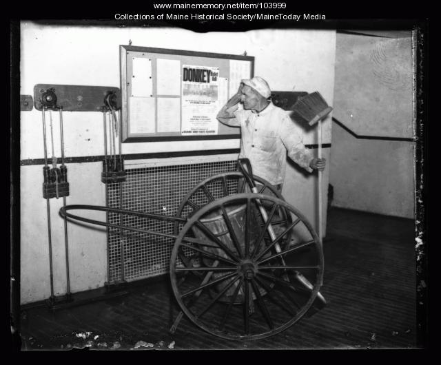 Janitor views donkey basketball advertisment, ca. 1930