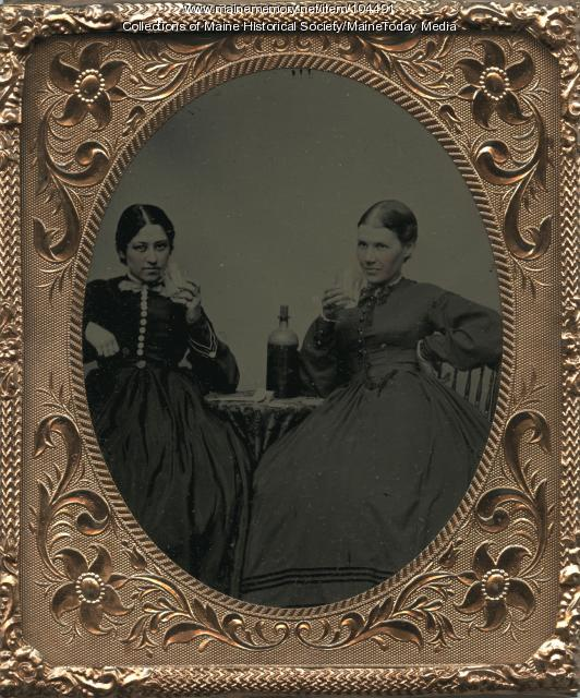 Two young women with whiskey glasses
