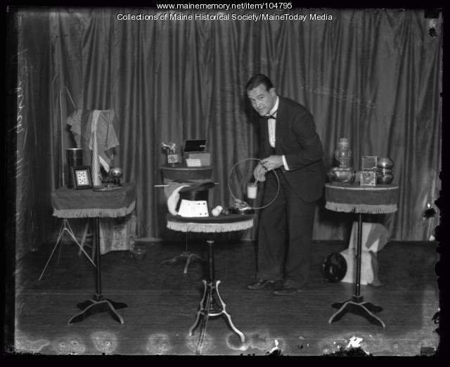 Roderick Macdonald Jr. setting up for a magic show, ca. 1922