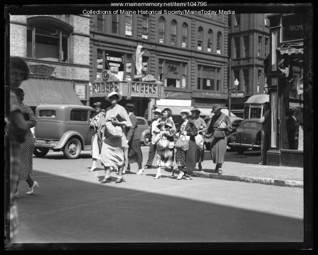 Women walking amongst clothing outlets on Congress Street, Portland, ca. 1922