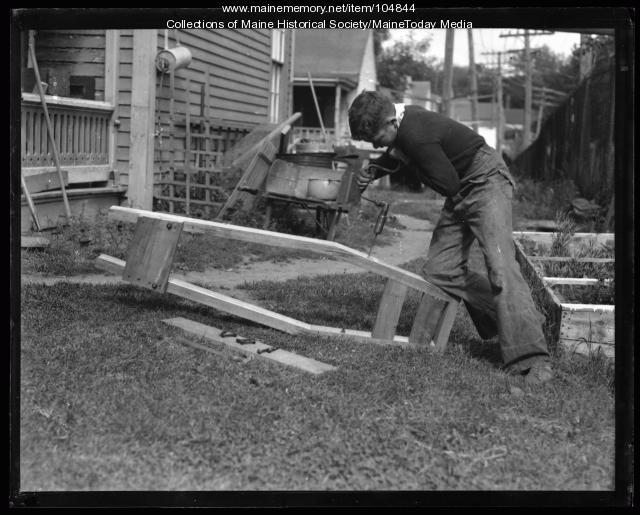 Boy building a soap box derby car, Portland, 1936