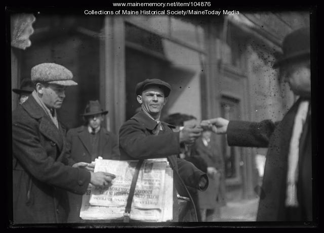 Man selling Evening Express, Portland, 1920