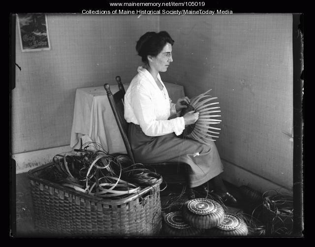 Pauline Shay weaving a basket, Portland, 1923