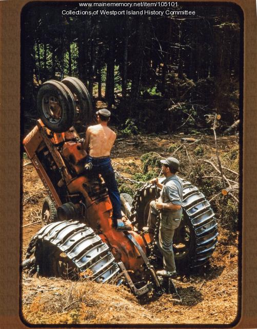 Upended tractor during logging operation, MacMahan Island, 1957